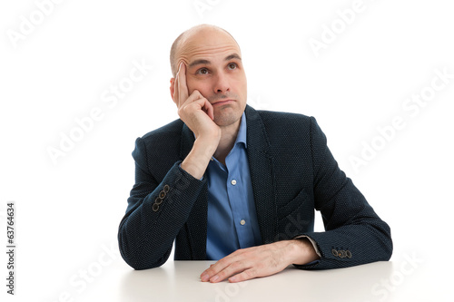 man sitting at the desk and dreaming