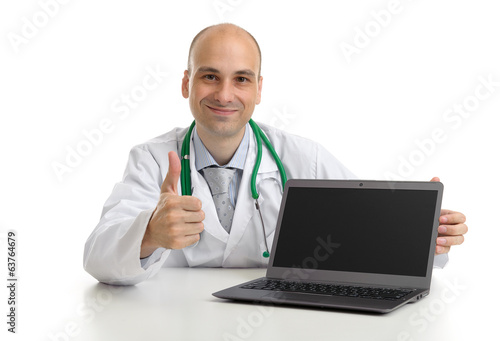 Young doctor expressing positivity and smiling with thumb up