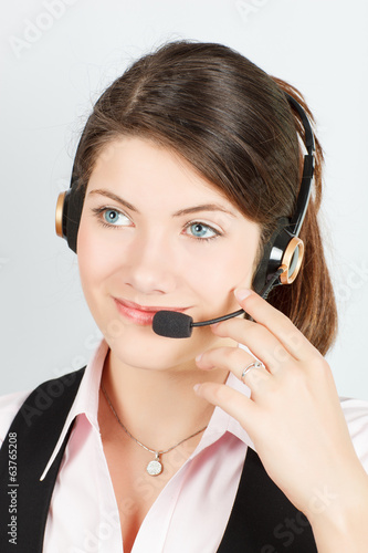 manager a girl with headsets and microphone speaks with a client