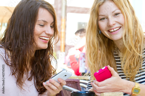Two girls and new smartphones