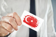 Turkish Businessman holding business card with Turkey Flag