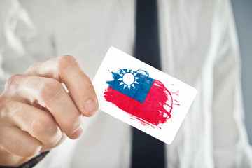 Businessman holding business card with Taiwan Flag