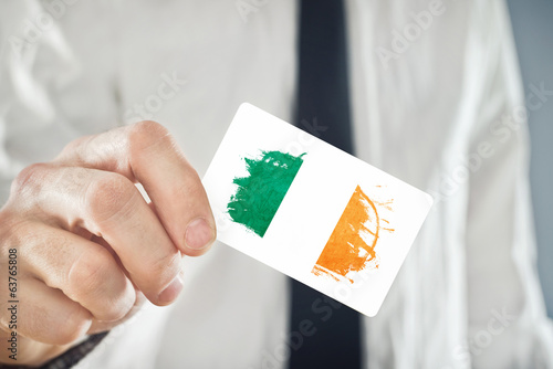 Irish Businessman holding business card with Ireland Flag