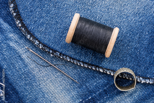 Roll of Black Thread and Jeans