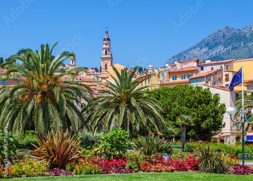 Colorful houses, green trees and palms in Menton.