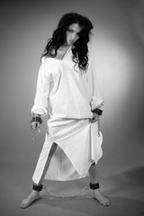 girl dressed in a white robe. black and white, studio