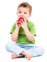 Portrait of a cute little boy with red apple