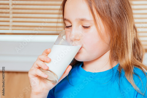 Girl is drinking milk