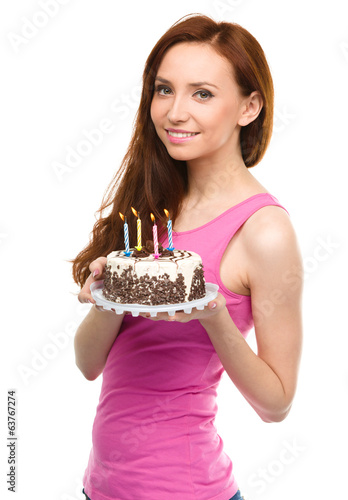 Young woman with anniversary cake
