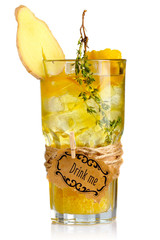 Yellow alcohol cocktail in glass with ginger slice and spices is