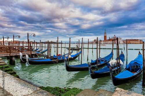 Gondolas tied on Grand canal in Venice, Italy.