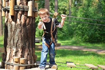 Happy boy in rope park