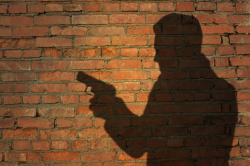 Human silhouette with handgun