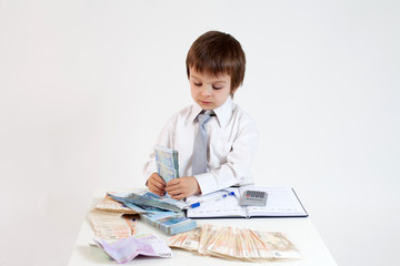 Young man, counting money and taking notes