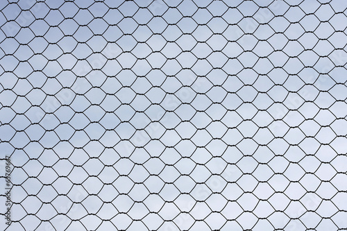 Metal wire fence protection isolated on sky for background
