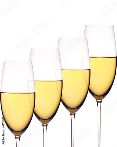 Wineglasses with white wine, isolated on white