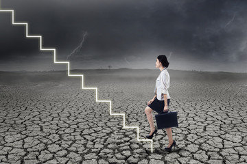 Businesswoman walking up on stairs