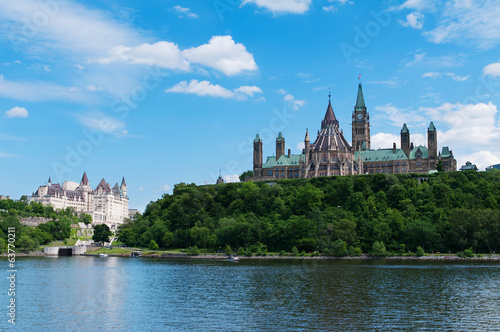 Canadian Parliament Hill viewed from across Ottawa river during