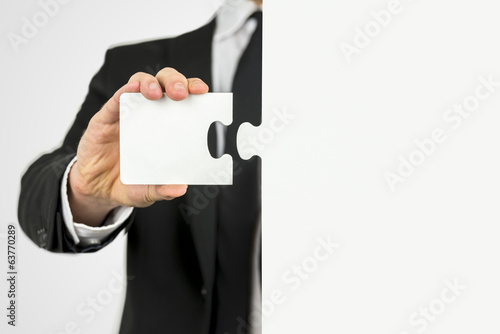 Businessman with a piece of the puzzle