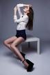 Beautiful brunette woman posing in studio.Fashion shot