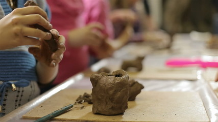 children molded out of clay figurines
