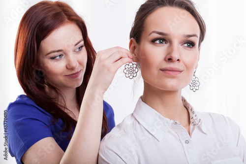 Woman trying on earring