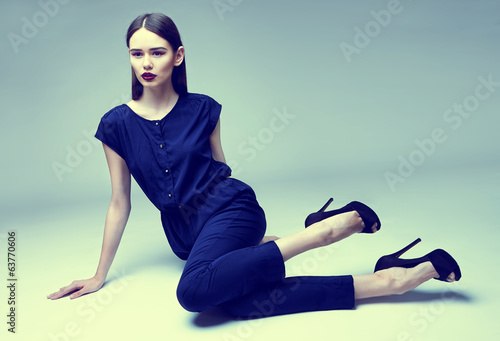 high fashion portrait of young elegant woman. Studio shot