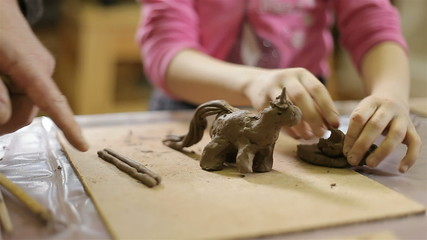 children molded out of clay figurines.