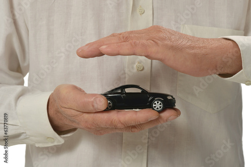 Mman with miniature car