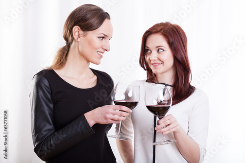 Stylish women raising their glasses