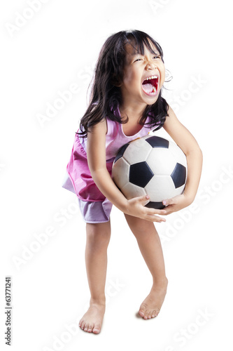 Cute girl play soccer ball isolated