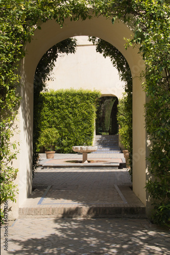 Arch in garden with fountain