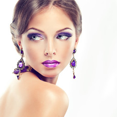 The girl with lilac makeup and manicure. Model with purple jewel