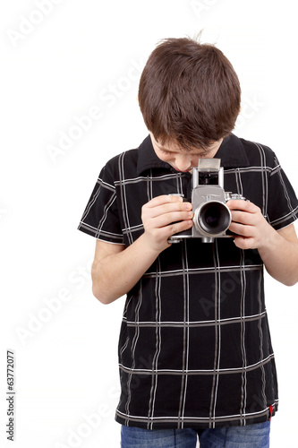 young boy with old vintage analog SLR camera