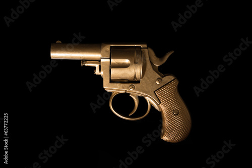 Old hand gun on a dark background