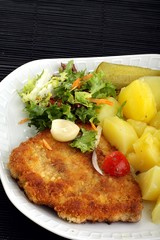 pork chop with potatoes and salad
