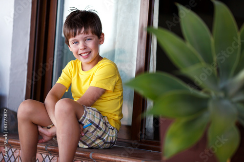 Close-up portrait of cheerful little boy