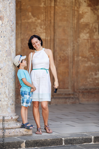 Mother and son visiting Alhambra palace