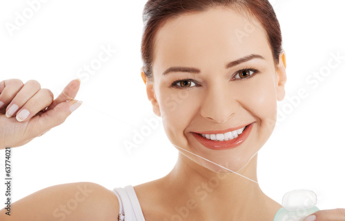 Beautiful woman with dental floss.