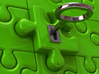 Silver key and green puzzle