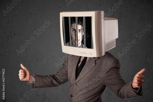 Business man with monitor on his head traped into a digital syst