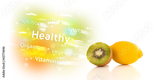 Colorful juicy fruits with healthy text and signs