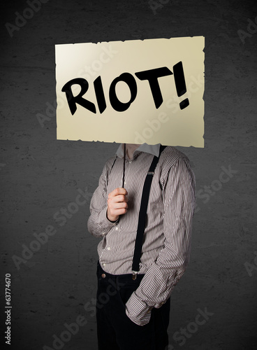 Businessman holding a protest sign