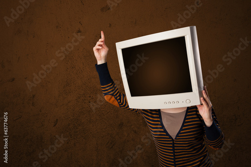 Girl with a monitor on her head and empty brown copyspace