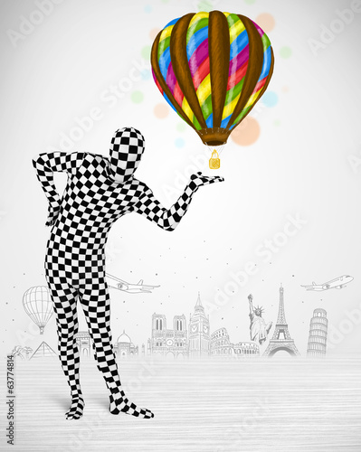 man in full body suit holding balloon
