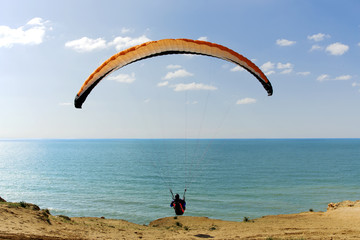 Paraglider flying above Mediterranean, Israel
