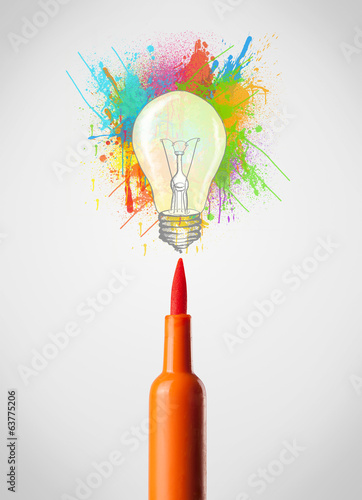 Felt pen close-up with colored paint splashes and lightbulb