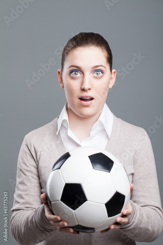 Young businesswoman woman with a soccer ball