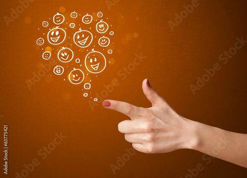 Group of happy smiley faces coming out of gun shaped hands