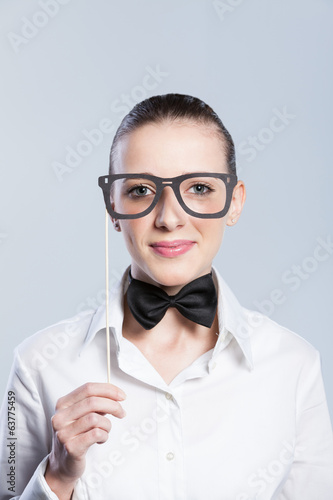 Portrait of young woman wearing funny eyeglass mask.